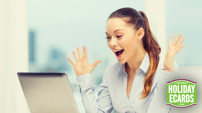 Business woman excited to receive e-greeting from a colleague.